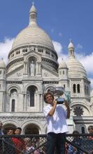 Guga holds up his 2001 French Open Roland Garros Trophy in front of the Sacre-Coeur Church.jpg