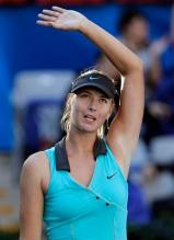 Maria Sharapova waves to the crowd at the 2010 China Open after winning a match.JPG