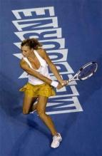 Maria Kirilenko gets ready to smack a backhand.jpg
