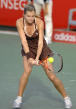 Maria Kirilenko hits a two-handed backhand.jpg