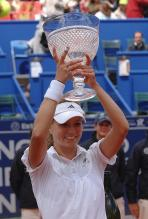 Maria Kirilenko holds up her trophy.jpg