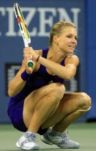 Maria Kirilenko squats after hitting a 2 handed backhand.JPG