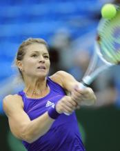 Maria Kirilenko 2 handed backhand on a high ball above her head.JPG