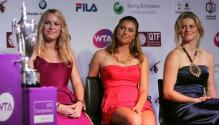 Vera Zvonareva in a red dress between Caroline Wozniacki and Kim Clijsters.JPG