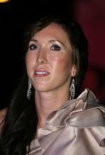 Jelena Jankovic in a silver dress at DOHA 2010.JPG