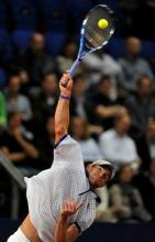 Andy Roddick flat serve at contact with racket in Basel 2010.JPG