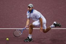 Andy Roddick forehand follow through in Basel 2010.JPG