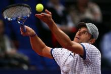 Andy Roddick ball toss and serve in Basel 2010.JPG