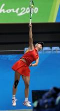 Peng Shuai leaps in the air to hit a serve in Guangzhou 2010.JPG