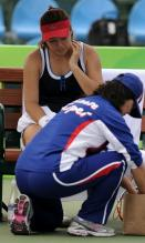 Chan Yung Jan gets her leg tended to in Guangzhou 2010.JPG