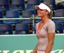 Maria Kirilenko smiles in her tennis wear.jpg