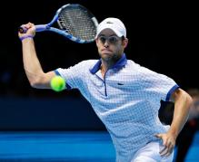 Andy Roddick sticks out his tongue and prepares to hit a forehand slice.JPG
