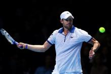 Andy Roddick looks to hit a forehand at O2 Arena 2010.JPG