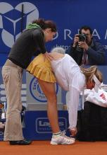 Maria Kirilenko gets her back massaged.jpg