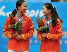 Peng Shuai and Yan Zi celebrate their bronze medals for doubles at China games 2010.JPG