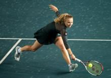 Caroline Wozniacki digs out a low volley in Hong Kong 2011.JPG
