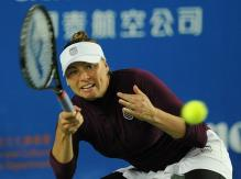 Vera Zvonareva bends her knees to scoop up a low forehand in Hong Kong 2011.JPG