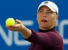 Vera Zvonareva sticks out her tongue as she serves.JPG