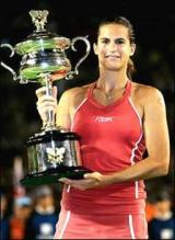 Amelie Mauresmo holds up the 2006 Australian Open Championship trophy.jpg