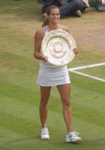 Amelie Mauresmo holds up the 2006 Wimbleton Championship trophy.jpg