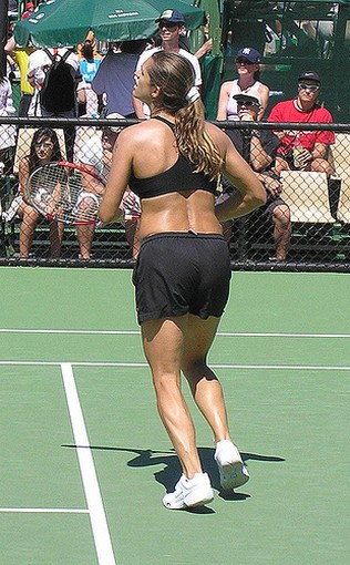 Mauresmo in black sports bra and shorts.jpg