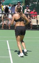 Amelie Mauresmo in black sports bra and shorts.jpg