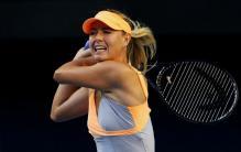 Maria Sharapova double handed backhand follow through during the 2011 Australian Open.JPG
