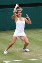 Amelie Mauresmo swing follow through.jpg