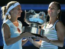Gisela Dulko holds the 2011 Australian Open doubles championship trophy with Flavia Penetta.JPG