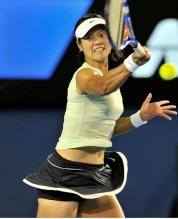 Li Na drives a forehand on a high ball during the Australian Open 2011 finals.JPG