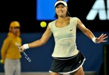 Li Na eyes the ball as she prepares to hit a forehand at the 2011 Australian Open finals.JPG
