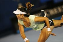 Li Na follows through on her serve during the 2011 Australian Open.JPG