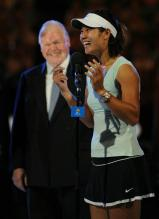 Li Na has a laugh as she talks on the microphone after the Australian Open 2011 championship match.JPG