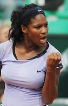 Serena Williams clenches her fist in celebration.jpg
