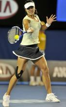 Li Na hits a forehand during the 2011 Australian Open championship finals.JPG