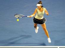 Li Na jumps to hit a forehand at the 2011 Australian Open.JPG