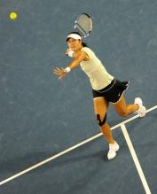 Li Na swinging volley during the Australian Open 2011.JPG