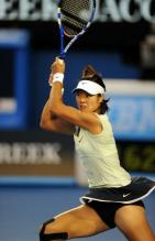 Li Na two handed backhand high follow through during the 2011 Australian Open finals.JPG