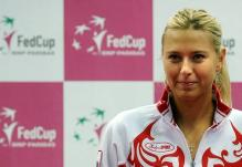 Maria Sharapova smiles during Russia Fed Cup 2011 press conference.JPG