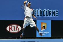 Kei Nishikori leaves the ground after hitting a forehand.JPG