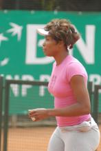 Venus Williams practices in pink top and tights.jpg