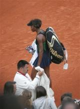 Venus is dejected after her loss at the 2008 French Open.jpg