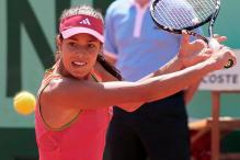 Ana Ivanovic goes for the backhand slice at the French Open 2011.JPG