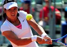 Li Na goes for the 2 handed backhand at the French Open 2011.JPG