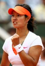 Li Na left fist pump celebration at the French Open 2011.JPG