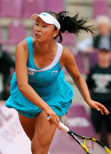 Peng Shuai follows through on her serve during the French Open 2011.JPG