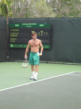 Robby Ginepri practices without a shirt on.jpg