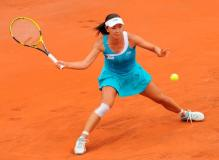 Peng Shuai goes for the forehand slice at the 2011 French Open.JPG