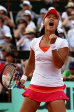 Li Na celebrates with a fist pump and yell at the French Open 2011 final.JPG