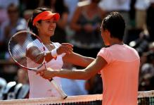 Li Na hugs Francesca Sciavone after beating her to win the 2011 French Open.JPG